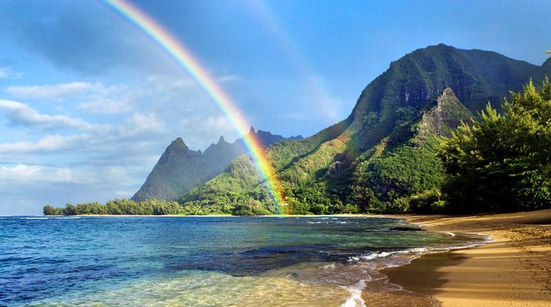 Rainbow over coastline, Haena Beach, Kauai, Hawaii, U.S.