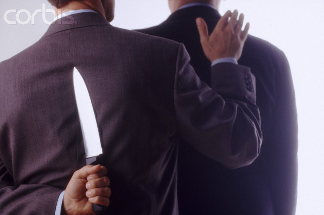 Backstabbing Businessman --- Image by © Jose Luis Pelaez, Inc./CORBIS