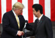 U.S. President Donald Trump shakes hands with Japan's Prime Minister Shinzo Abe during delivering a speech to Japanese and U.S. troops as they aboard Japan Maritime Self-Defense Force's (JMSDF) helicopter carrier DDH-184 Kaga at JMSDF Yokosuka base in Yoko