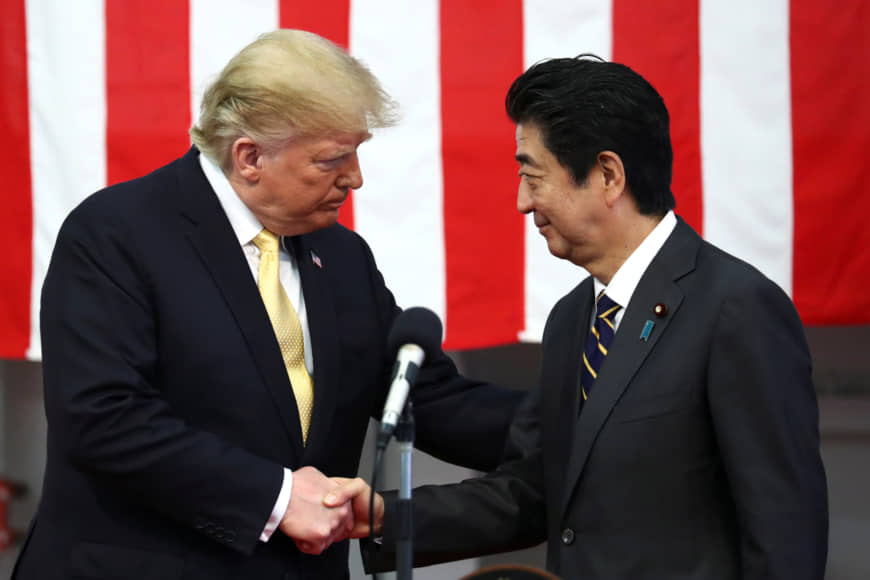 U.S. President Donald Trump shakes hands with Japan's Prime Minister Shinzo Abe during delivering a speech to Japanese and U.S. troops as they aboard Japan Maritime Self-Defense Force's (JMSDF) helicopter carrier DDH-184 Kaga at JMSDF Yokosuka base in Yokosuka, south of Tokyo, Japan, May 28, 2019. REUTERS/Athit Perawongmetha/Pool