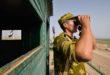 """KHATLON REGION, TAJIKISTAN - AUGUST 14, 2018: A serviceman of Tajikistan's Panj Border Service detachment on an observation tower of the Somon border outpost. The unit was formed as the 48th Sarai-Kamar Border Service detachment in 1928 and carried out mission during the Soviet-Afghan War of 1979-1989. Nozim Kalandarov/TASS  Òàäæèêèñòàí. Õàòëîíñêàÿ îáëàñòü. Âîåííîñëóæàùèé Ïÿíäæñêîãî ïîãðàíè÷íîãî îòðÿäà íà ñìîòðîâîé âûøêå ïîãðàíè÷íîé çàñòàâû """"Ñîìîí"""". Ñîçäàííûé â 1928 ãîäó 48-é Ñàðàé-Êàìàðñêèé ïîãðàíè÷íûé îòðÿä â 1954 ãîäó áûë ïåðåèìåíîâàí â Ïÿíäæñêèé è óñïåøíî âûïîëíÿë áîåâûå çàäà÷è â Àôãàíñêîé âîéíå 1979-1989 ãã. Íîçèì Êàëàíäàðîâ/ÒÀÑÑ"""