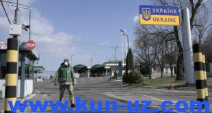 epa08301185 A border guard officer walks on the closed border crossing between Poland and Ukraine in Shegyni, Ukraine, 17 March 2020. Ukrainian borders will be closed from 17 March to 03 April 2020. Ukraine has temporarily stopped issuing visas over the spread of the novel coronavirus. The Cabinet of Ministers decided to introduce quarantine across Ukraine from 12 March to 03 April 2020. In this regard, Ukraine temporarily banned the entry of foreigners and closed the international regular passenger service.  EPA-EFE/MARKIIAN LYSEIKO